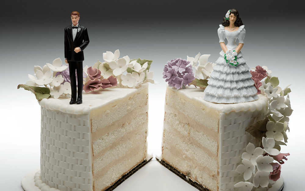 Couple on top of a wedding cake