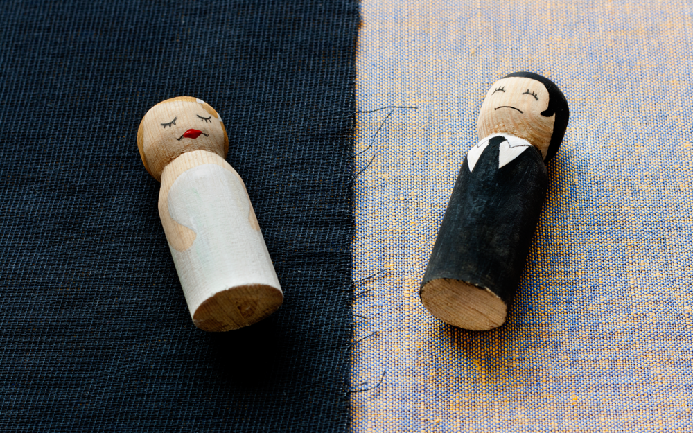 Wooden carvings of a bride and groom