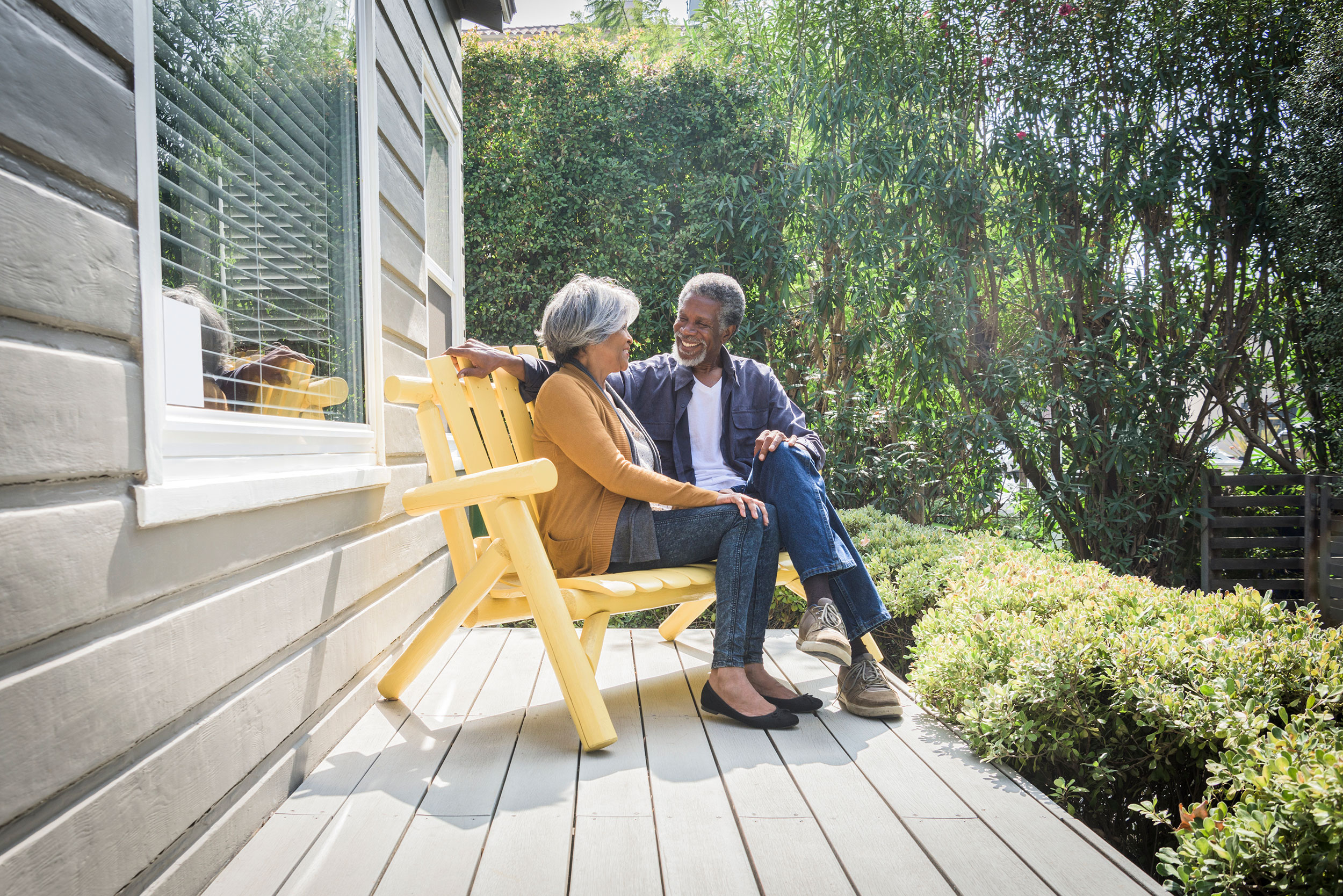 Couple talking on the porch